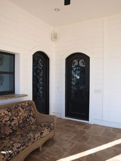 Custom Black Twin-Arch Top Iron Doors