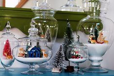 Christmas Village in jars with epsom salt. Brilliant!! Adds so much sparkle... and the snow is contained! Would be cute for a tablescape too!