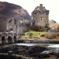 Eilean Donan is a small tidal island where three lochs meet, Loch Duich, Loch Long and Loch Alsh, in the western Highlands of Scotland; since the castle's restoration in the early 20th Century, a footbridge has connected the island to the mainland. A picturesque castle that frequently appears in photographs, film and television dominates the island, which lies about 1 kilometre (0.62 mi) from the village of Dornie.