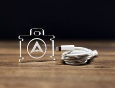 Amigo - It is unique because it uses the stability and predictability of the phone cable for the foundation of the stand.