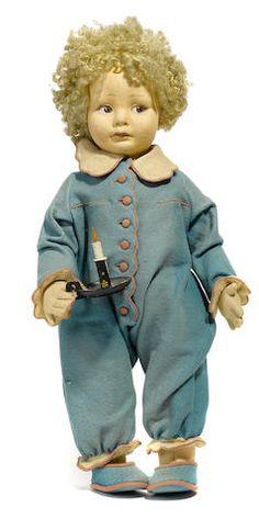 A Lenci felt boy doll with candlestick