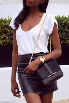 White t shirt and black leather skirt