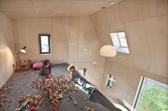 angular-home-addition-with-plywood-lined-interior-12-top-level.jpg