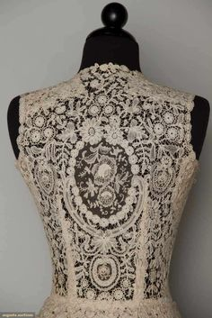 Vintage Lace Wedding Dress Amazing lace vintage wedding dress! Handmade bobbin & Pt de Gaz needle lace c. 1860-1870, possibly a veil remade into wedding gown c. 1940, fitted sleeveless bodice, full open-front, skirt w/ train, B 34, W 24; t/w 1 1940 cream underdress BROOKLYN MUSEUM.