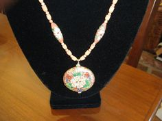 Close up of Cloissonne, Coral and Vermeil Findings Necklace