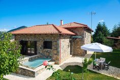 Entire home/flat in Kardaras, Mainalo, Greece. Villa Mainalis is a stylish stone house in an idyllic setting at the slopes of Mainalon Mountain, just away from Athens and less than fro. Summer Winter, Athens, Ski, Gazebo, Greece, Villa, Outdoor Structures, Patio, Seasons