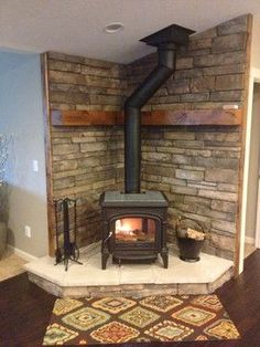 Wood Stove Stone Work Fireplace/Woodstoves - traditional - Living Room - Other Metro - Cashmere Construction Wood, Pellet Stove, Fireplace Design, Wood Burner, Living Room Wood, Standing Fireplace, Farmhouse Fireplace, Corner Wood Stove, Wood Burning Stove Corner