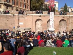 Students from the Cavour High School hold a lesson outside the Colosseo metro stop in Via dei Fori Imperiali in protest against the government's planned cuts in education. 8 November 2012.