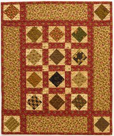 Natural greens are highlighted with rich red sashing in a doll quilt that can span the seasons. Square-in-a-square units form a grid shape that echoes the geometric shapes in the rest of the quilt. Fabrics are from assorted collections by Jo Morton for Andover Fabrics [1]. [1] http://andoverfabrics.com