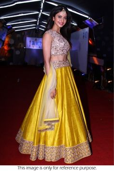 Bollywood Style Sargun Mehta Silk Lehenga In Yellow and Beige Colour NC2225 Yellow and Beige Colour Silk Fabric Designer Bollywood Lehenga Comes With Matching Blouse Which Can Be Stitched Up To Size 4...