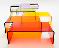 U ACRYLIC COFFEE TABLE  Materials: Clear or color-infused fire-polished acrylic Dimensions: 46W x 24D x 16H  Options: Color, size