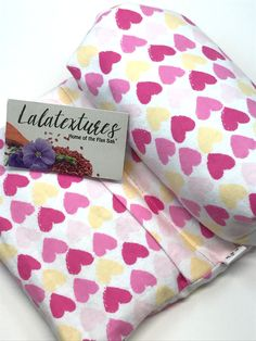 """The Best Gift! Heat therapy, large microwavable flax heating pad, unscented, yellow and pink hearts, The """"Flax Sak"""" Hot/cold pack with removable/washable cover. Natural pain relief. A great pain reliever and bed warmer, this 8 x 18 in. large microwavable heating pad has a segmented muslin insert filled with food grade flax seeds. Its cover is removable and washable making it a hygienic product. It is also wonderful for using as a gentle cold pack. It comes unscented and is easy to use..."""