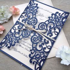 Loving these Navy and Blush Laser Cut invitations!