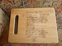 An old family recipe burned into a cutting board...genius! What a great gift idea! That would make a nice wedding gift; perhaps add some flowers or other flourishes.
