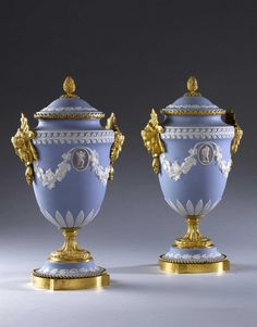 A PAIR OF ORMOLU WEDGWOOD VASES, England, circa 1850 A pair of late century Wedgewood vases decorated in the traditional manner with white neo-classical decoration against a pale blue ground, each having an oval cameo in the centre of each vase. Wedgewood China, House Ornaments, Objet D'art, Antique China, Wedgwood, Vases Decor, China Porcelain, Art Nouveau, Blue And White