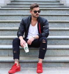 Stefano Tratto in a black leather jacket, red sneakers and starbucks coffee. Men's fashion