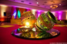 I like these centrepieces!! Might be able to get a bunch from Pakistan. Different than lanterns. Adds more of the desi feel