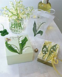 Small boxes covered with strands of lilies