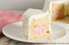 Strawberry Cheesecake Stuffed Angel Food Cake is looks impressive and  tastes amazing! serenabakessimplyfromscratch.com