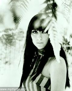 I like to pretend I look like Cher (the early years). Sadly, I look like a busted version with crooked bangs :/