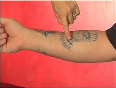 How to cover up a tattoo with regular makeup.  http://video.about.com/tattoo/How-to-Cover-Up-a-Tattoo.htm