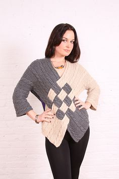 Cable Crossover Sweater.  I love Ravelry, I need to use it more.  This sweater looks fun to make.