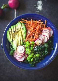 A bright, fresh salad is packed with protein, full of color. Thick, slightly sweet vinaigrette with sesame oil and fresh ginger makes the perfect topping.