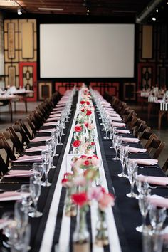 Long black, white, pink and red tables make for a stunning and modern reception setting. Whimsical Smog Shoppe wedding