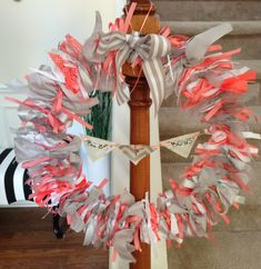 coral and gray ribbon wreath for bibs and bows themed baby shower