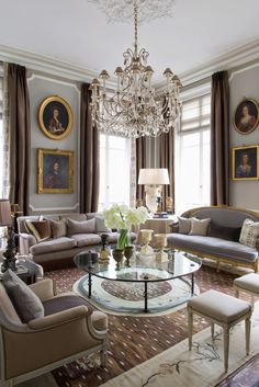 Apartment in the style of Louis XVI in Paris. Stunning living room with central coffee table and chairs and sofas facing inwards.