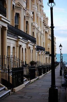 Brighton, UK - street with a view. Would LOVE to live in one of these street town houses :)