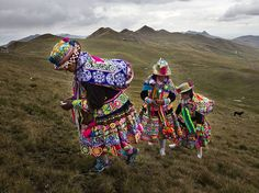 Fortune Favors the Bold. Photograph by Gianni Bulacio - In the highland province of Canas in Peru, women dressed in traditional costumes ascend a hill, where they will dance and sing to give encouragement to the participants of the battle of Chiaraje. The ritual battle is fought to ensure the fertility and abundance of the land. Their songs raise the request for the protection of the apus [mountain spirits] for communities and their warriors, as well as for crops and livestock