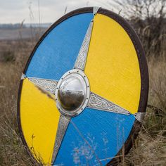 Ready for battle painted viking shield with carrying strap and beautiful etching.