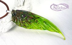 handmade lampwork glass wing pendant necklace by MaidOfGlassOnEtsy on Etsy