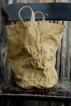 enhabiten fabric basket on Etsy.  I like the shabby canvas-y look.  Would be so handy as a project bag.