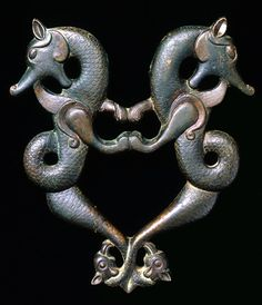 A Turkish thirteenth-century bronze door handle in the form of dragons; here, they are positive symbols, intended to ward off evil. (The David Collection)