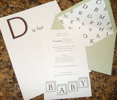 ABC book where everyone creates one page to go in a baby book for the mommy.  Mail them out in advance...Different and cute.