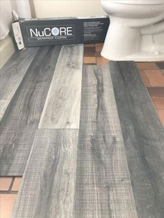 Vinyl plank flooring that's waterproof. Lays right on top of your existing floor. Vinyl plank flooring that's waterproof. Lays right on top of your existing floor. Love this color we're using in our bathroom remodel. Bathroom Remodel Pictures, Remodel Bathroom, Shower Remodel, Inexpensive Bathroom Remodel, Bathroom Makeovers On A Budget, Bathroom Images, Bathroom Decor Ideas On A Budget, Easy Bathroom Updates, Restroom Remodel