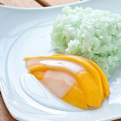 Thai green sticky rice with mango and sweetened coconut milk.