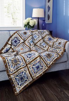 Flowering Mandala Afghan - Grand Prize winner of our Afghan contest. Billie Birchfield designed this stunning afghan using Mary Maxim Prism and Ultra Mellowspun yarns. Knit in Fair Isle squares and sewn together.