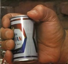 Andre the Giant holding a full size beer can. holy shit