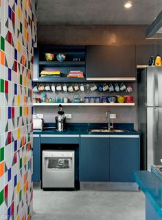 multicolor tile accent wall / blue cabinets