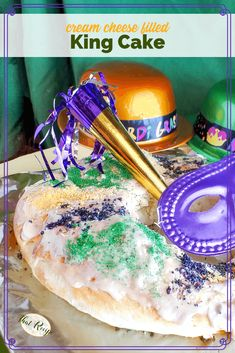 This decadent Cream Cheese Filled King Cake is perfect for your Mardi Gras celebration. And it is easy to make too! #mardigras #kingcake #neworleans #thatrecipeblog
