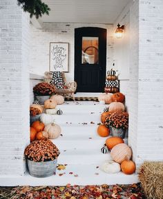 Beautiful fall entry to a home. The perfect way to welcome fall right up your front steps!