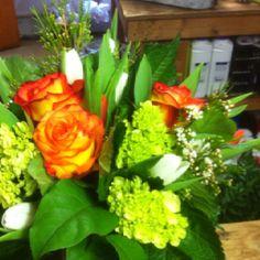 Orange roses and green hydrangeas