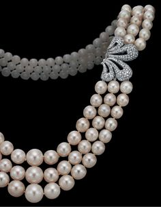 Three-strand natural pearl and diamond necklace.