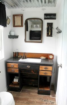 Our Home - Knick Of Time  ...An old desk becomes the vanity and  notice the ceiling .. love it!  What A Great Idea!