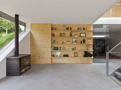 Modern wall of shelves with eclectic grouping of books and   accessories.