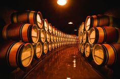 Wine Barrels in Napa Valley winery by Charles O'Rear