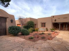 With adobe or stucco walls the modern style of pueblo for Adobe style homes for sale